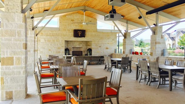 Trinity_Falls_amenity_center_fireplace_tables_chairs